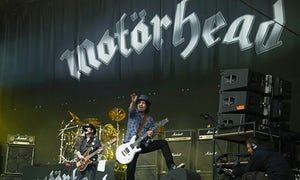 Lemmy (left) appearing alongside guitarist Phil Campbell on the Pyramid stage during Glastonbury music festival on 26 June, 2015 at Worthy Farm, Glastonbury, England.
