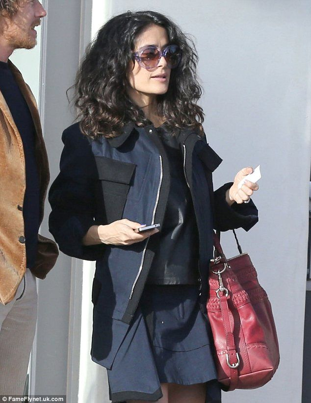 Salma Hayek's daughter Valentina carries some pretty flowers after ...
