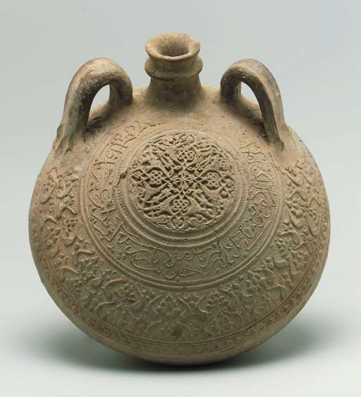 AN ILKHANID LARGE UNGLAZED POTTERY PILGRIM FLASK PROBABLY NORTH EAST IRAN, 14TH CENTURY