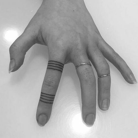 15 tiny finger tattoo ideas that are beyond dainty.