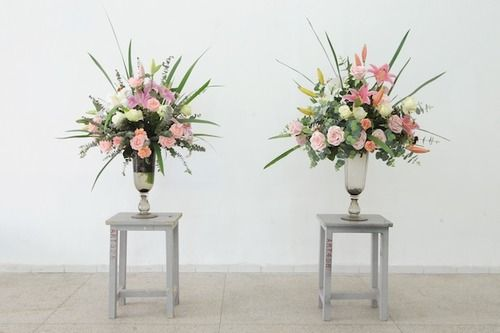 simon kentgens, 'Bloom' (2009).  Two nearly identical flower bouquets. One is real and one is fake. The real flowers gradually go bad during the exhibition, while the fake flowers stay exactly the same.