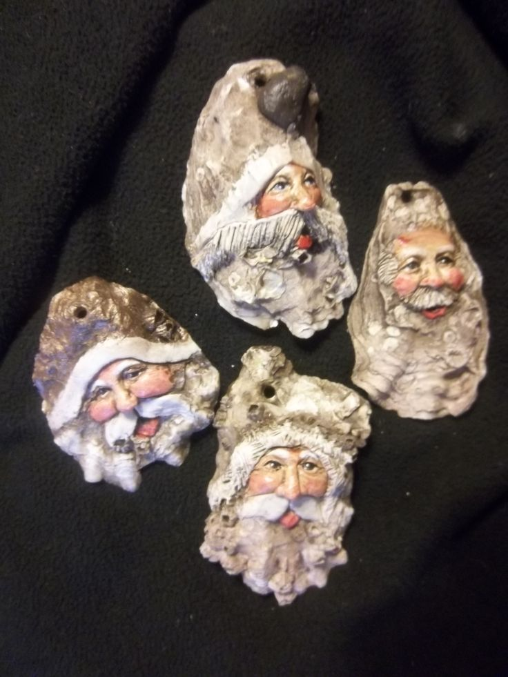 A group of Neutral Oyster Shell Santa's