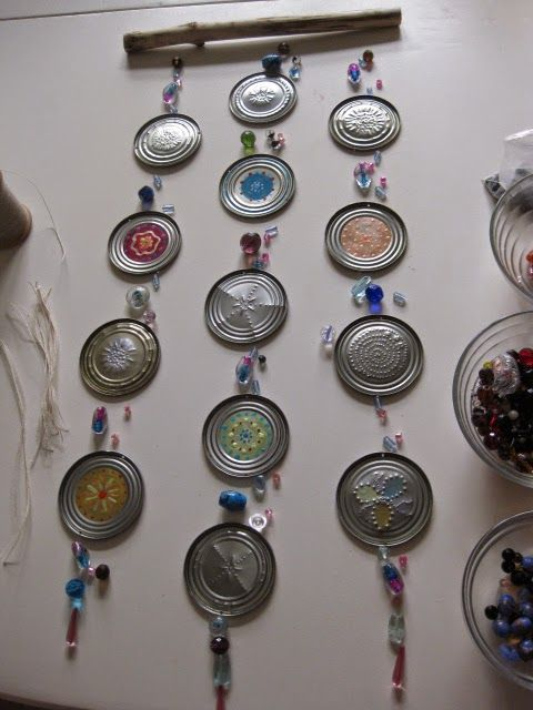 Windchime made from lids from cans. Use a screwdriver, nail and awl to make designs!