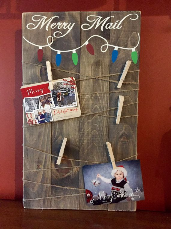 **Take 10% off now thru Friday Nov. 18th with coupon code -design10off Wooden Merry Mail Holiday card display. Handcrafted from pine, stained in general finishes walnut and hand painted. Lightly sanded for a distressed look. This is a rustic sign and there may be knots and imperfections in the wood. We believe that this makes each one beautiful and unique. Sign available in 14X24, 14X30 or 14X36. Hanging hardware included on back as well as 10 cloths pins and twine. Ships in 3-5 business...
