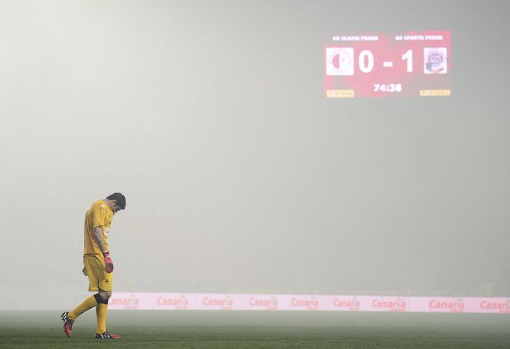 Slavia Praha goalkeeper Karel Hrubeš leaves the pitch after play is suspended because of smoke from pyrotechnics during the Slavia-Sparta derby on September 27th, 2014.