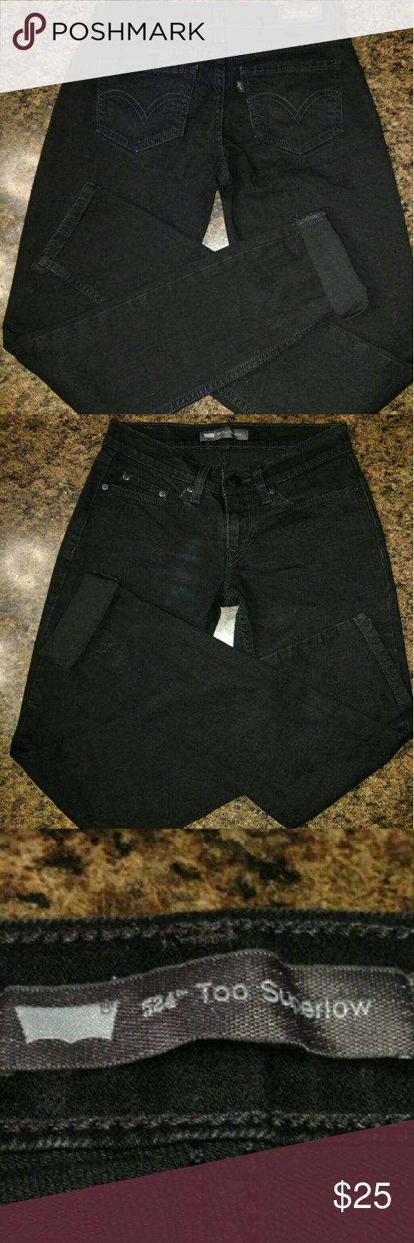 Whiskered black Levi's 524 Too Superlow Whiskered black Levi's 524 Superlow jeans. Nice condition. The flash from the camera makes it look like there's a spot on them but it isn't....Perfect condition. Levi's Jeans Skinny