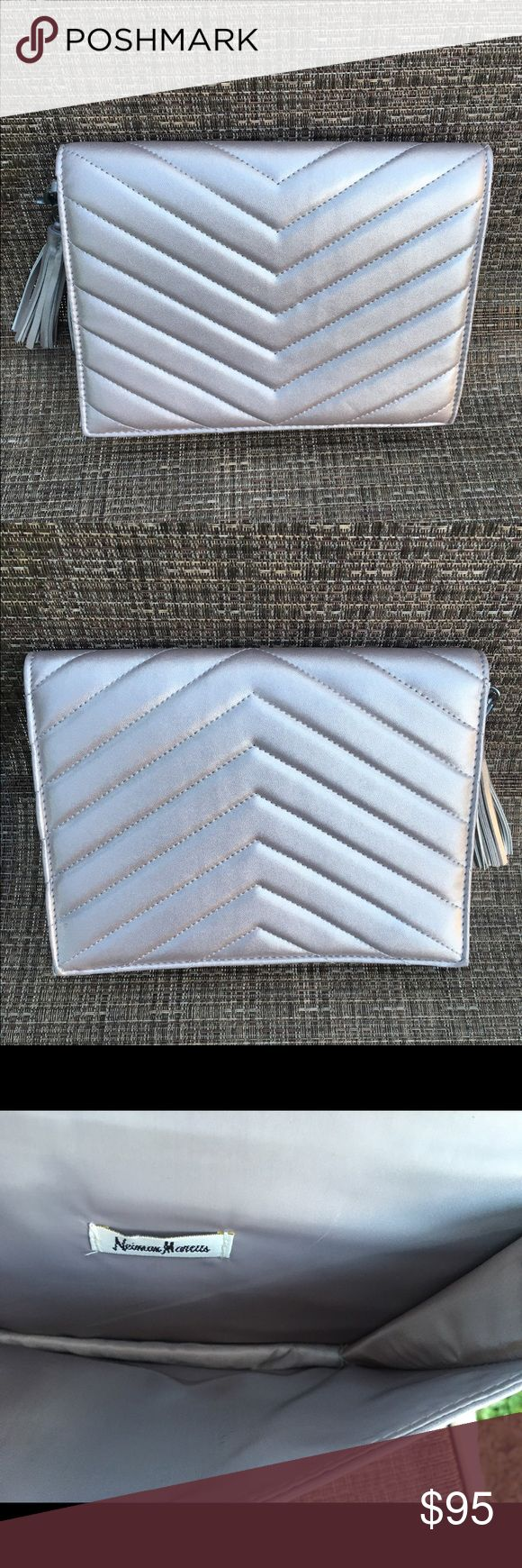 Neiman Marcus Metallic Tassel Clutch Neiman Marcus Metallic Tassel Clutch.  Like new.  Perfect clutch handbag for that black dress or another evening dress.  This is spacious enough for your phone, credit cards, lip stick and keys: Neiman Marcus Bags Clutches & Wristlets