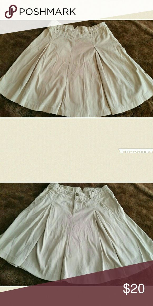 Armani exchange beige  khaki skirt with pockets. Armani Exchange beige khaki skirt with pockets.  Great skirt, size 10 Armani Exchange Skirts A-Line or Full