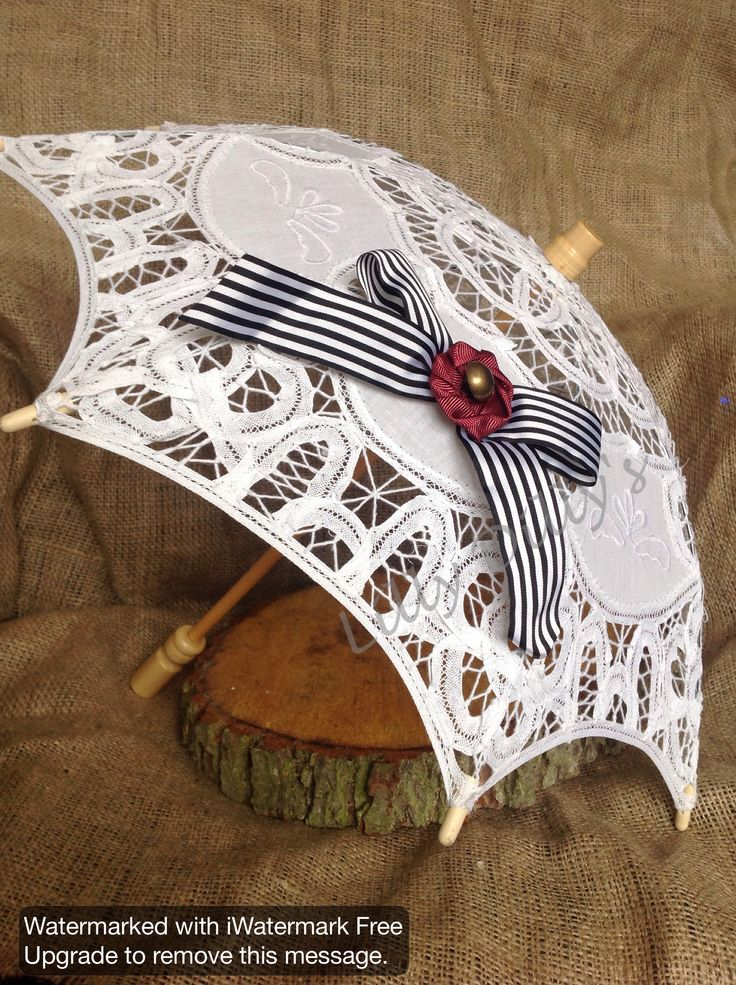 Beautiful hand decorated mini parasol from Lilly Dilly's  #wedding #parasol #bespoke #couture #child #lace #bow #monochrome #marsala #flowergirl