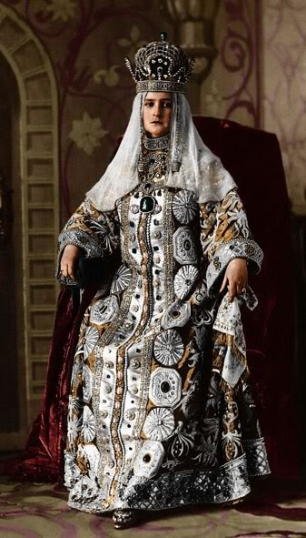 The Empress Alexandra in her costume for the 1903 ball at the Hermitage.Faberge created a special period necklace to hold the aincent emerald pendant