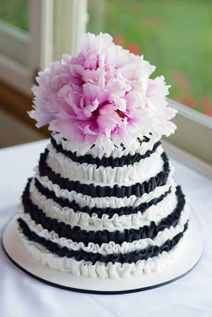 Ruffled cake with fresh pink peonies