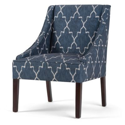Featuring a striking cobalt blue Moroccan print, the handcrafted Hayworth Accent Chair by Simpli Home makes an elegant addition to any home. Details include solid wood legs, coordinating welting and swooping arms that offer a gorgeous mid-century profile.