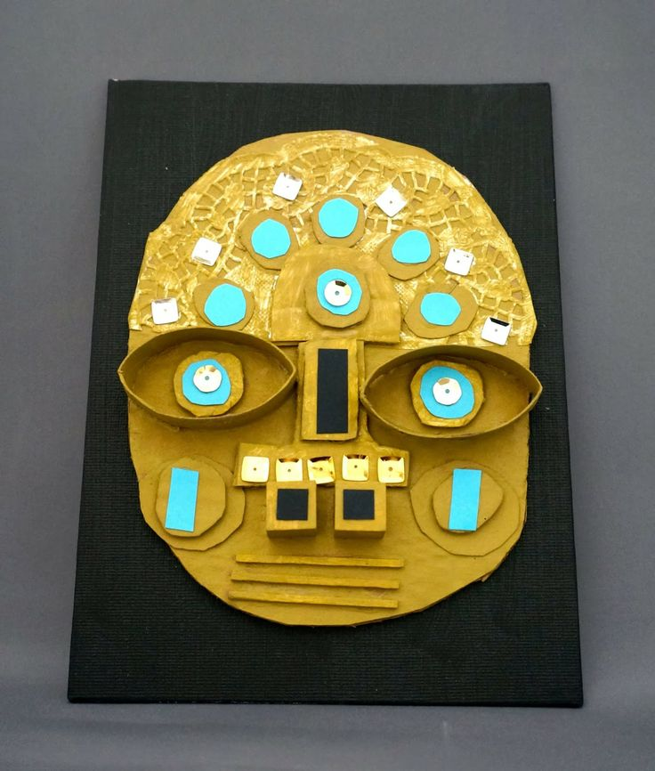 Peruvian masks - elementary art lesson, cardboard, recylced materials