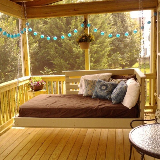 Bed swing on screened in porch. Use twin size mattress and simply sheets to cover it with outdoor pillows from Target. So relaxing.