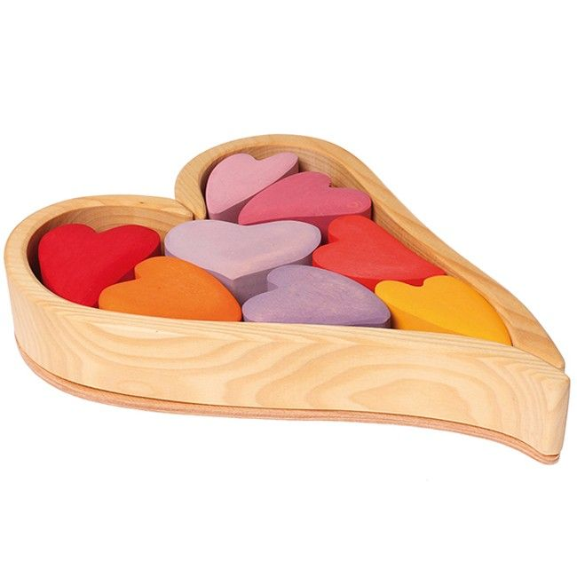 Grimm's Wooden Building Block Hearts are multi-faceted - the wooden 'box' actually comes apart to create different building elements that can be combined with the assorted coloured wooden hearts to create all sorts of sculptures. Great for training fine motor skills, Grimm's Building Blocks Hearts also make a fantastic decorative element in your home or a unique present for someone you heart #woodentoys #grimms #valentines
