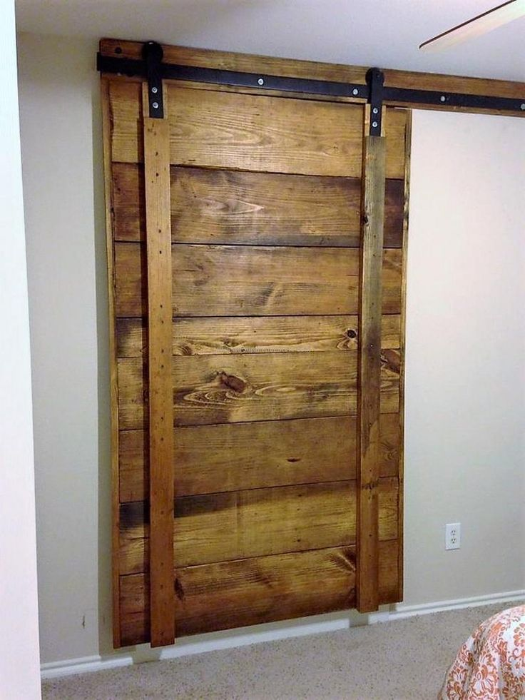 Check out this barn-style door we finished recently. Made entirely from reclaimed wood pallets. Austin Pallet Furniture