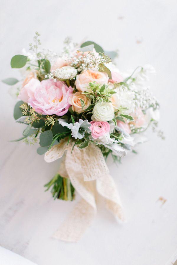 Spring wedding bouquet, photo by When He Found Her. #ranunculus #peach #weddingbouquet