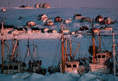 Winter snows cover a fishing village along the Gaspé Peninsula in Quebec's Gulf of St. Lawrence...