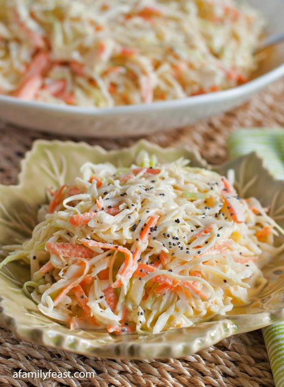 Coleslaw  Ingredients     6 cups shaved green cabbage     1 medium peeled and shredded carrot     1 cup mayonnaise     3 Tablespoons cider vinegar     1 teaspoon celery salt     ¼ teaspoon white pepper     ¼ teaspoon Colman's powdered mustard     ½ teaspoon poppy seeds     2 Tablespoons white sugar     1 Tablespoon extra virgin olive oil
