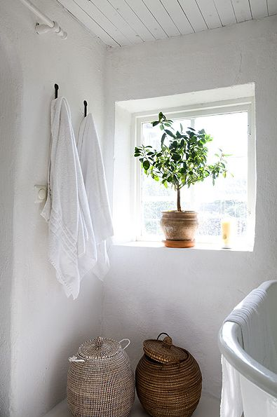 lovely white bathroom with baskets