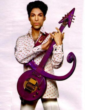"""Prince Rogers Nelson and his """"the Artist Formerly Known as Prince"""" symbol-shaped guitar."""