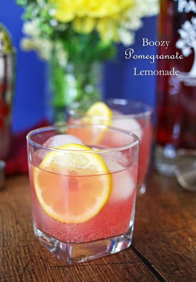 Boozy Pomegranate Lemonade - the perfect summertime refreshment. Ice cold lemonade, vodka & pomegranate liqueur make for a delicious way to cool down. on kleinworthco.com @pamaliqueur #PAMACelebrateSummer