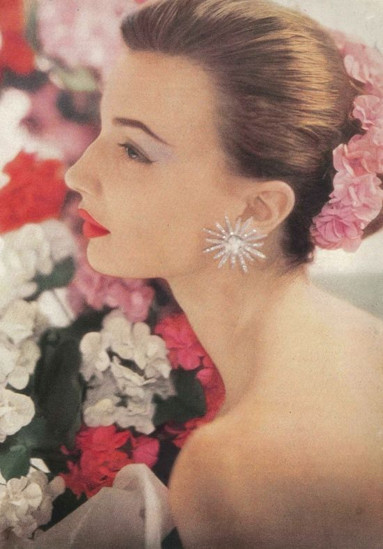 1950s model Maria Reachi photographed wearing 'Pink Geranium' lipstick by Charles of the Ritz from Vogue June 1952.