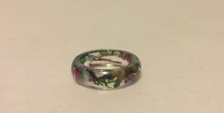 A personal favorite from my Etsy shop https://www.etsy.com/listing/508680518/pressed-flowermoss-resin-ring-sz-7