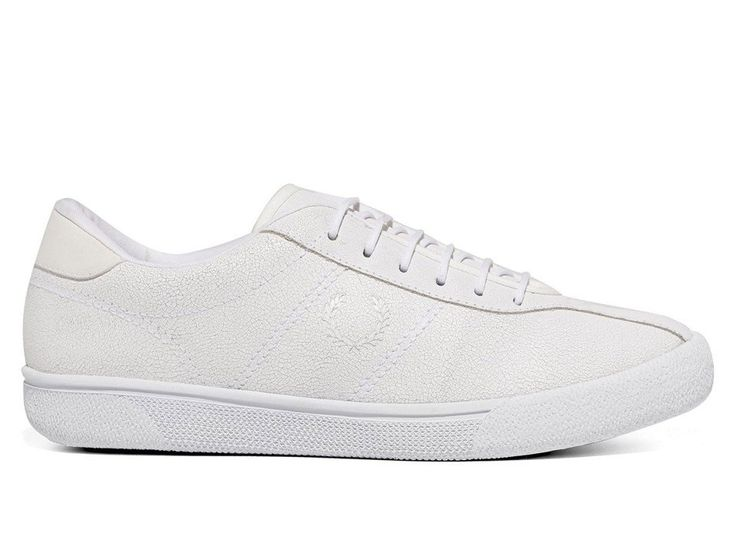 Fred Perry have been an icon for decades, but their roots as a brand run even deeper than their impressive fashion pedigree. These reissued tennis shoes go back past cultural milestones like Britpop, Punk, Northern Soul, and Swinging London, all the way back to 1934, the year the man himself took home the first of three consecutive Wimbledon Gentlemen's Singles championships. The Wimbledon dress code, then and now, calls for players to dress in all-white. That is just how the Reissue…
