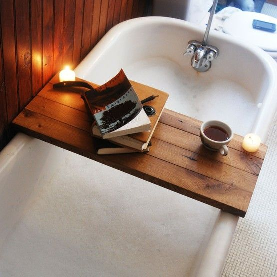 bathtub / board as table top / books / tea / good idea