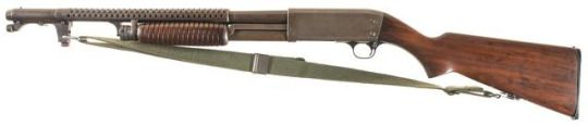 Ithaca Model 37 trench gun Manufactured by Ithaca gun company based on Browning and Pedersen patents c.WW2 - 61654. 12 gauge 4+1 round tubular magazine, pump action repeater, slamfire capable, trench gun configuration - heat shield and bayonet lug.