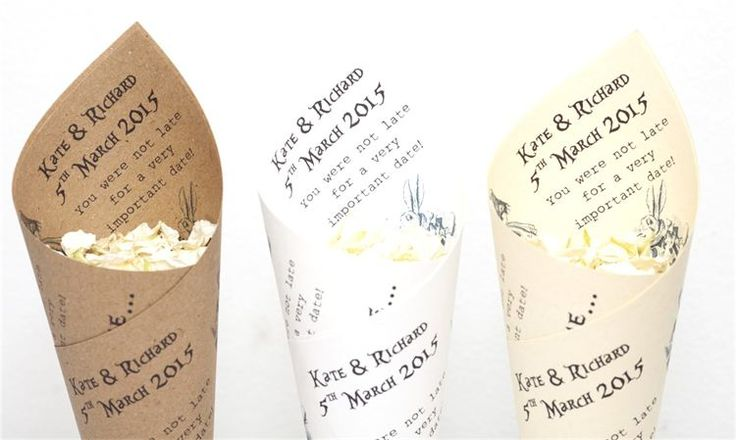 The Confetti Cone Company- wedding - Alice in wonderland cones, personalised with your names and the date of the wedding on. Available in cream, white or kraft paper. £3.50 for 10 www.confetti-cones.co.uk
