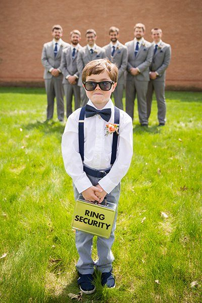 "Upgrade your ring bearer to ""ring security,"" official briefcase and all. Position him so that he's in the foreground and the groomsmen are grinning from afar to recreate this fun snapshot."