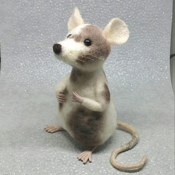 Hand made wool sculpture, beautifully made with every attention to detail. This needle felted animal would be a perfect addition to your collection. This needle felted mouse stands approximately 3.5 inches tall. He is made from a central polyester fibre core covered with natural wool