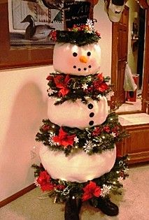 Use an old worn out Christmas tree and make an adorable snowman