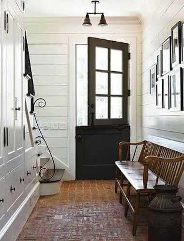 """Dutch Doors: """"Beautiful floors, built-in under-stair storage, a lovely wooden bench, paneled wooden walls, and a gorgeous Dutch door."""""""
