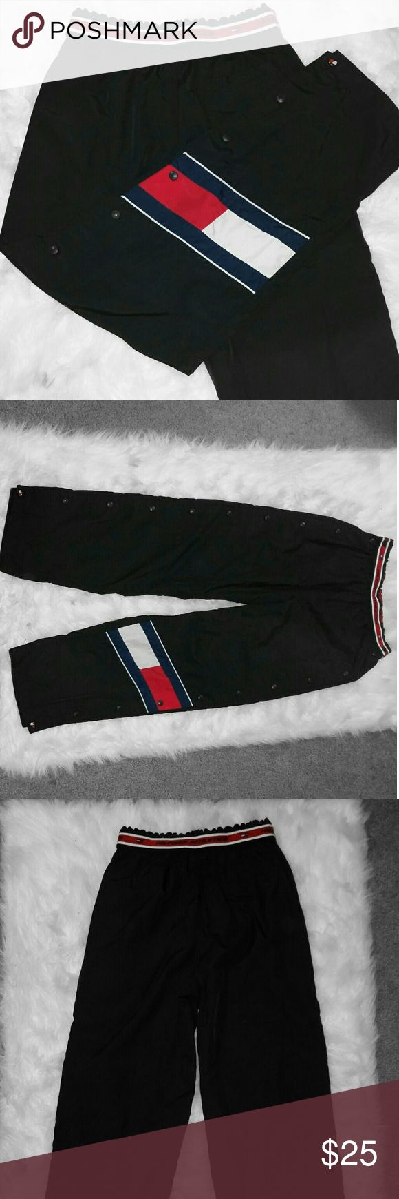 ❤️Tommy Hilfiger vintage logo athletic pants ❤️ Size medium Tommy Hilfiger windbreaker pants. These pants are so cute and feature the iconic logo on the knee and the writing on the waistband. These are a must have in your wardrobe! Save on shipping and add to a bundle! ❤️ Tommy Hilfiger Pants Track Pants & Joggers