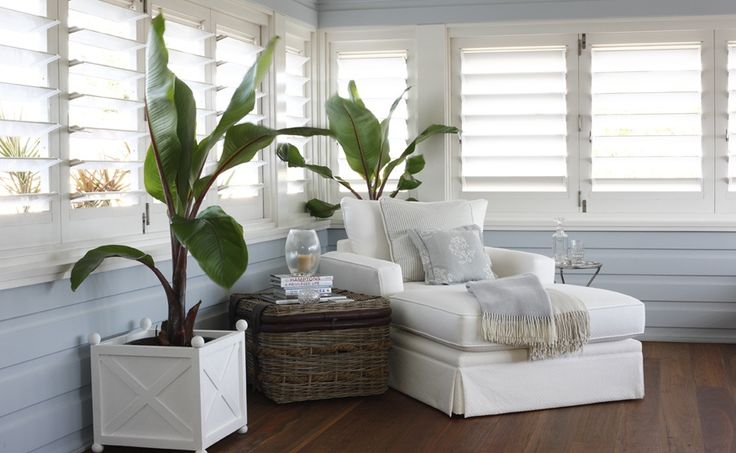 Coco republic styled house. White lounge, cane, plantation shutters, floorboards, white and blues. I could curl up here all day. love love love