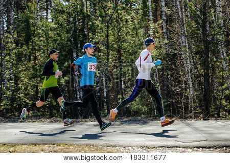 Chelyabinsk Russia - April 22 2017: leaders group runners run asphalt road in park Spring half marathon