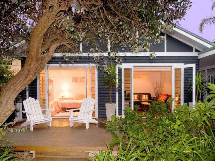 bank of French doors to platform deck note color palette Cottage in Sydney Australia