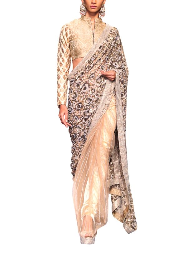Siddartha Tytler brings to you an ornate saree with elaborate embroidery and a chic blouse for occasions when you want to make a lasting style statement. The beige net saree with a striped body extends into a heavy 3D floral embroidered pallu with a jaal border. Adding an alluring touch to the saree is the full sleeve golden brocade blouse with a front zipper that is crafted like a jacket.