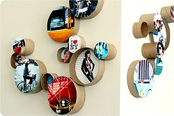 Cute and thrifty idea for photo displays.  I bet you could even use scrapbook paper and have it look awesome.  I would paint the tubes first though...