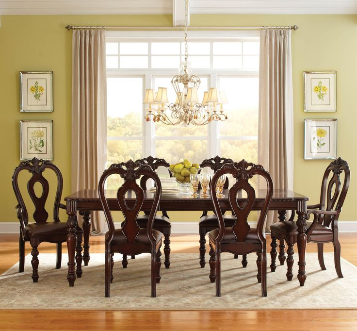 Westchester Traditional Style Table With Two Arm Chairs And Four Side Features Rounded Corners