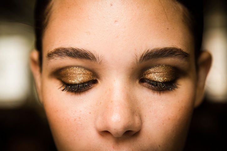 Spring Makeup Trend: Gilded Lids At Jason Wu's show, Lancôme makeup artists smudged Le Crayon Khol in Black Coffee into creases and lined the top lashes with Jason Wu for Lancôme Artliner in Noir.