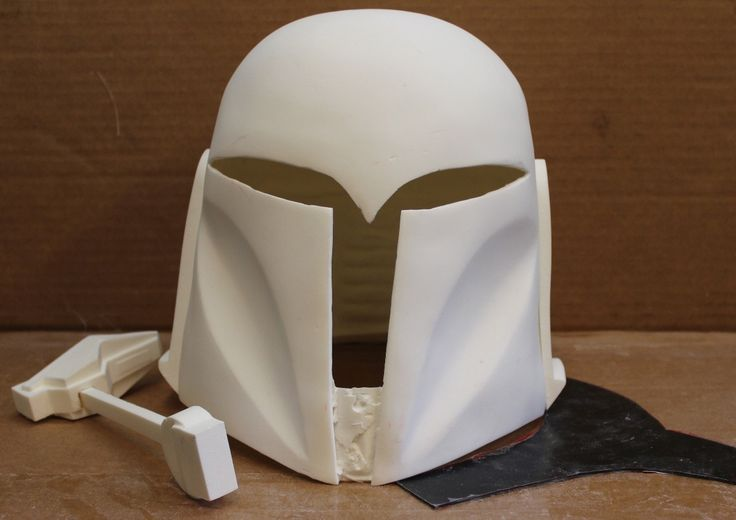 """There are two options for this helmet: •OPTION B AS SHOWN ABOVE but not painted or 100% finished. Includes the constructed RF and stalk and a pre-cut visor separate for installation after painting. JULY SALE PRICE: $125 to the US, $145 to the world (approx. raw weight after trim - 2.0lbs/0.9kg) MEASUREMENTS: •ear to ear: 8"""" •front to back: 9"""" •inside height: crown to back: 9""""; crown to front: 10"""" •circumference: comfortably up to 24""""  THE Mandalorian Arsenal"""