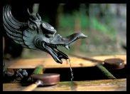 Dragon spitting water – basin in Enryaku-ji Temple on Mount Hiei, Kyoto, Japan