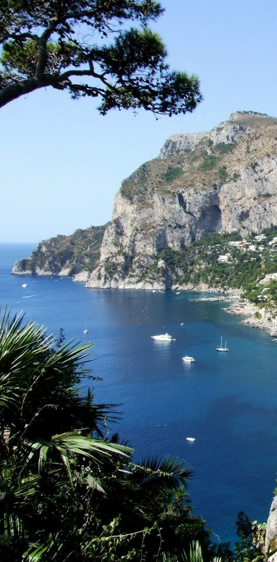 The Island of Capri, in Italy, is famous for its dramatic cliffs. Learn more about it through our free travel-guides to Italy.