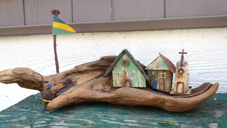 When I found this wood on the beach I knew I would upcycle it into the background for a fishing village. Reminds me of someplace in Maine. Houses & church are made from 100-yr-old wainscoting, ...