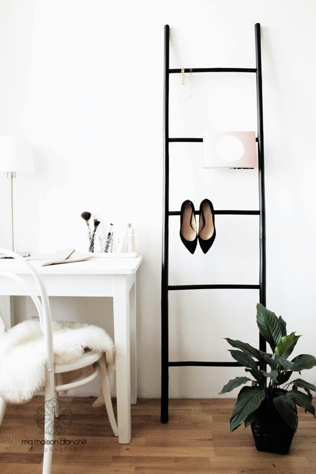 Black Broste bamboo ladder in our bedroom I like the idea of hanging shoes by their heels
