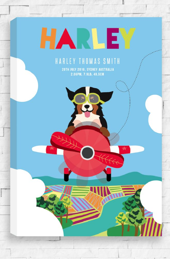 A personalised canvas, fit for a … newborn! Dream Big canvas features an excited dog flying a bright red plane through the countryside. A funky multicolored font is used to spell the personalised name and all the other details placed below. An ideal gift for a baby boy or girl.